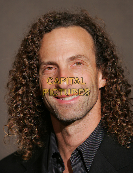 KENNY G.The 2nd Annual Louis Vuitton United Cancer Front Gala held at Universal Studios, Stage 24 in Universal City, California .November 8th, 2004.headshot, portrait, curly long hair, stubble, facial hair.www.capitalpictures.com.sales@capitalpictures.com.©Debbie Van Story/Capital Pictures