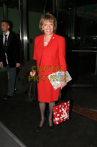ESTHER RANTZEN.Daily Mirror's Pride Of Britain Awards at the London Hilton, Park Lane.15 March 2004.full length, full-length, red suit, bag.www.capitalpictures.com.sales@capitalpictures.com.© Capital Pictures.