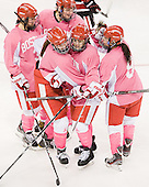 Kasey Boucher (BU - 3), Jenn Wakefield (BU - 9), Kathryn Miller (BU - 4), Jill Cardella (BU - 22) and Kasey Boucher (BU - 3) celebrate Cardella's goal. - The Boston University Terriers defeated the visiting Northeastern University Huskies 3-2 on Saturday, January 28, 2012, at Agganis Arena in Boston, Massachusetts.