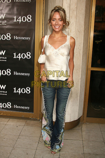 "RACHEL REENSTRA.""1408"" World Premiere at Mann's National Theatre, Westwood, California, USA..June 12th, 2007.full length jeans denim pattern floral print white cream camisole top satin purse bag .CAP/ADM/BP.©Byron Purvis/AdMedia/Capital Pictures"