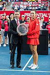 Wang Qiang of China (R) poses for trophy after the singles final match agasint Dayana Yastremska of Ukraine at the WTA Prudential Hong Kong Tennis Open 2018 at the Victoria Park Tennis Stadium on 14 October 2018 in Hong Kong, Hong Kong.