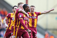 Dom Poleon of Bradford City is congratulated by his team mates after scoring during the Sky Bet League 1 match between Bradford City and Gillingham at the Northern Commercial Stadium, Bradford, England on 24 March 2018. Photo by Thomas Gadd.