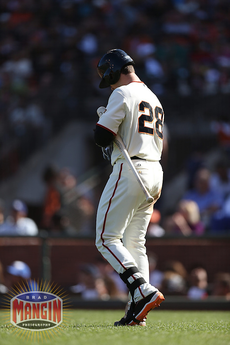 SAN FRANCISCO, CA - JULY 6:  Buster Posey #28 of the San Francisco Giants walks to the plate for an at bat against the Los Angeles Dodgers during the game at AT&T Park on Saturday, July 6, 2013 in San Francisco, California. Photo by Brad Mangin