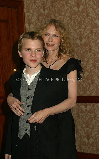 Mia Farrow and son Shamus at the 30th International Emmy Awards in New York. November 25, 2002. Please byline: Alecsey Boldeskul/NY Photo Press.   ..*PAY-PER-USE*      ....NY Photo Press:  ..phone (646) 267-6913;   ..e-mail: info@nyphotopress.com