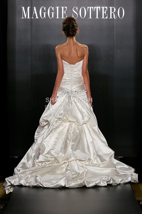 Model walks the runway in a Rebecca wedding dress from the Sottero and Midgley Spring 2012 collection, during  Couture: New York Bridal Fashion Week 2012