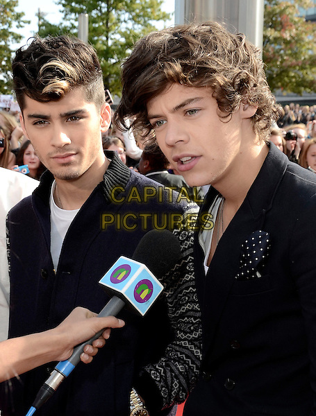 One Direction - Zayn Malik and Harry Styles.BBC Radio 1 'Teen Awards 2012' at Wembley Arena, London, England. .7th October 2012.half length suit jacket black top microphone interview mouth open .CAP/ROS.©Steve Ross/Capital Pictures.
