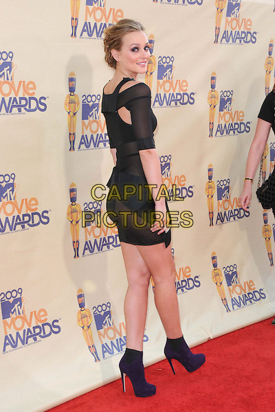 LEIGHTON MEESTER .The 2009 MTV Movie Awards held at Universal Ampitheatre  in Universal City, California, USA..May 31st, 2009 .full length black dress ankle boots cut out away purple sheer looking over shoulder .CAP/DVS.©Debbie VanStory/Capital Pictures.
