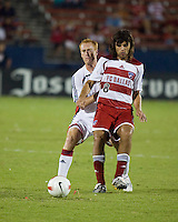 New England Revolution midfielder Jeff Larentowicz (13) marks FC Dallas midfielder Juan Toja (8).  New England Revolution defeated FC Dallas 3-2 to capture the 2007 Lamar Hunt U.S. Open Cup at Pizza Hut Park in Frisco, TX on October 3, 2007.