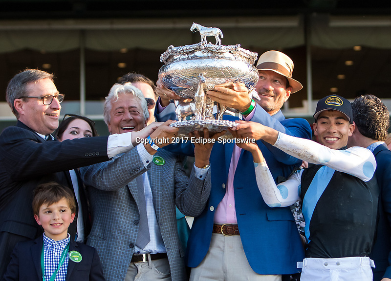 ELMONT, NY - JUNE 10: The Tapwrit connections hold the trophy as they celebrate after winning the 149th Belmont Stakes on Belmont Stakes Day at Belmont Park on June 10, 2017 in Elmont, New York (Photo by Sue Kawczynski/Eclipse Sportswire/Getty Images)