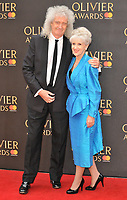 Brian May and Anita Dobson at the Olivier Awards 2018, Royal Albert Hall, Kensington Gore, London, England, UK, on Sunday 08 April 2018.<br /> CAP/CAN<br /> &copy;CAN/Capital Pictures<br /> CAP/CAN<br /> &copy;CAN/Capital Pictures