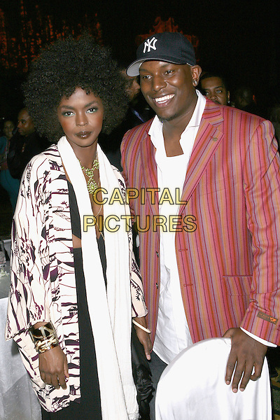 LAURYN HILL & TYRESE GIBSON.Tinseltown to Gotham Pre-Oscar Event held at the Regent Beverly Wilshire Hotel, Beverly Hills, California, USA..March 2nd, 2006.Photo: Zach Lipp/AdMedia/Capital Pictures.Ref: ZL/ADM.Lauren half length afro baseball cap hat pink stripes striped jacket white scarf pattern.www.capitalpictures.com.sales@capitalpictures.com.© Capital Pictures.