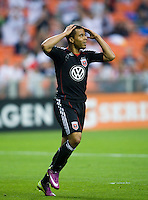 Charlie Davies (9) of D.C. United reacts to a missed chance on goal during the game at RFK Stadium in Washington, DC.  D.C. United tied the Colorado Rapids, 1-1.