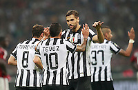 Calcio, Serie A: Milan vs Juventus, Milano, stadio San Siro, 20 settembre 2014.<br /> Juventus forward Carlos Tevez, of Argentina, second from left, celebrates with teammate Fernando Llorente, of Spain, after scoring the winning goal during the Italian Serie A football match between AC Milan and Juventus at Milan's San Siro stadium, 20 September 2014. Juventus won 1-0.<br /> UPDATE IMAGES PRESS/Isabella Bonotto
