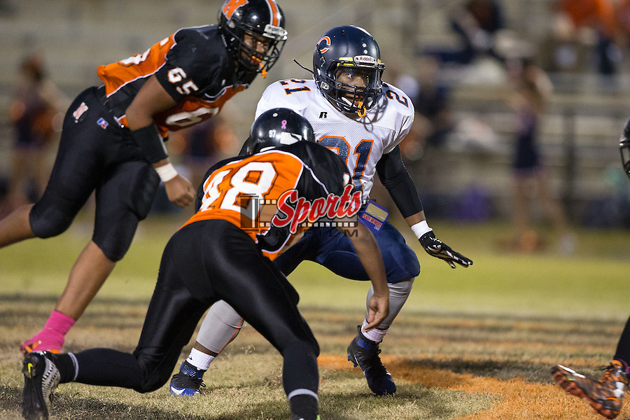 Jay Wilkerson (21) of the Carson Cougars runs with the football during first half action against the Northwest Cabarrus Trojans at Trojan Stadium October 22, 2015, in Concord, North Carolina.  The Cougars defeated the Trojans 21-20.  (Brian Westerholt/Sports On Film)