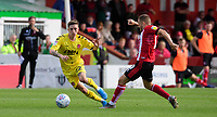 Fleetwood Town's Ashley Hunter vies for possession with Lincoln City's Joe Morrell<br /> <br /> Photographer Chris Vaughan/CameraSport<br /> <br /> The EFL Sky Bet League One - Lincoln City v Fleetwood Town - Saturday 31st August 2019 - Sincil Bank - Lincoln<br /> <br /> World Copyright © 2019 CameraSport. All rights reserved. 43 Linden Ave. Countesthorpe. Leicester. England. LE8 5PG - Tel: +44 (0) 116 277 4147 - admin@camerasport.com - www.camerasport.com