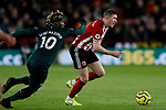 John Lundstram (r) of Sheffield United runs past Allan Saint-Maximin of Newcastle United during the Premier League match at Bramall Lane, Sheffield. Picture date: 5th December 2019. Picture credit should read: James Wilson/Sportimage