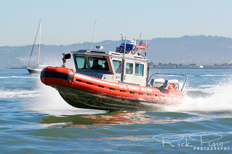 A Defender Class Response Boat (RB-S) searches patrols along the San Francisco Waterfront during 2006 Fleet Week activities. The RB-S was designed as a homeland security and law enforcement platform to conduct escorts, enforce security zones, and deliver boarding teams. Photographed 10/07