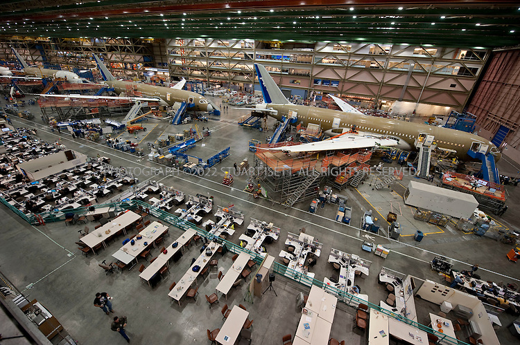 10/22/2009--Everett, WA, USA..At Boeing's Everett, Wash., the first Boeing 787s are under production, destined for Japan's ANA airlines. ..The 787-8 Dreamliner will carry 210 - 250 passengers on routes of 7,650 to 8,200 nautical miles (14,200 to 15,200 kilometers), while the 787-9 Dreamliner will carry 250 - 290 passengers on routes of 8,000 to 8,500 nautical miles (14,800 to 15,750 kilometers).  A third 787 family member, the 787-3 Dreamliner, will accommodate 290 - 330 passengers and be optimized for routes of 2,500 to 3,050 nautical miles (4,600 to 5,650 kilometers). ..In addition to bringing big-jet ranges to mid-size airplanes, the 787 will provide airlines with unmatched fuel efficiency, resulting in exceptional environmental performance. The airplane will use 20 percent less fuel for comparable missions than today's similarly sized airplane. It will also travel at speeds similar to today's fastest wide bodies, Mach 0.85. Airlines will enjoy more cargo revenue capacity. Passengers will also see improvements with the new air...©2009 Stuart Isett. All rights reserved.