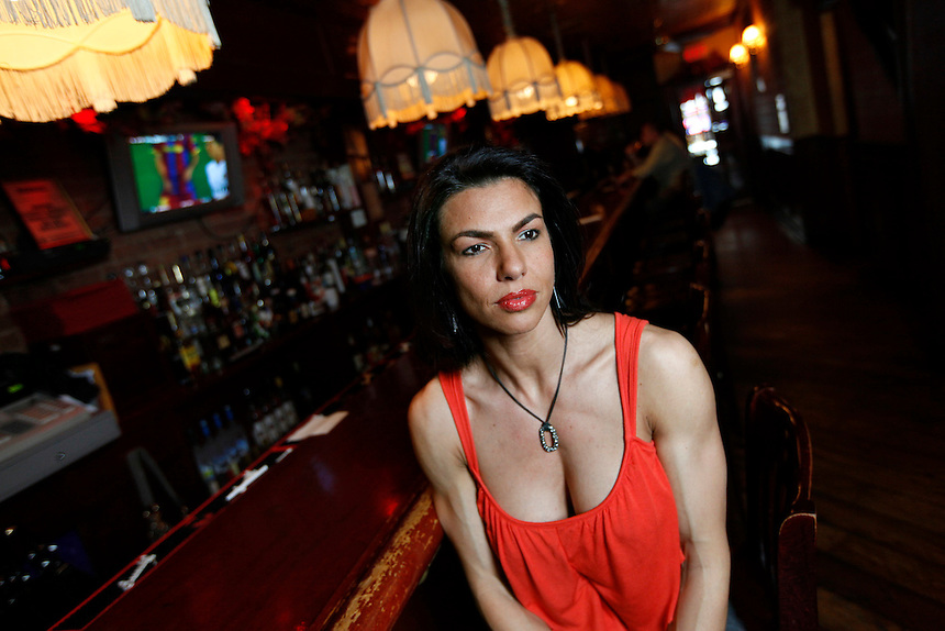 Mona Muresan, a professional bodybuilder and owner of Nebraska Steakhouse in the Financial District, sits at the bar of her establishment, Manhattan, NY.  Muresan, 36, has won seven state and national bodybuilding titles since 2008, and was hired to be the new editor-in-chief of Muscle & Fitness Hers magazine in November of 2011.
