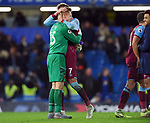 West Ham United goalkeeper David Martin celebrates with Andriy Yarmolenko of West Ham United at the end of the Premier League match at Stamford Bridge, London. Picture date: 30th November 2019. Picture credit should read: Robin Parker/Sportimage