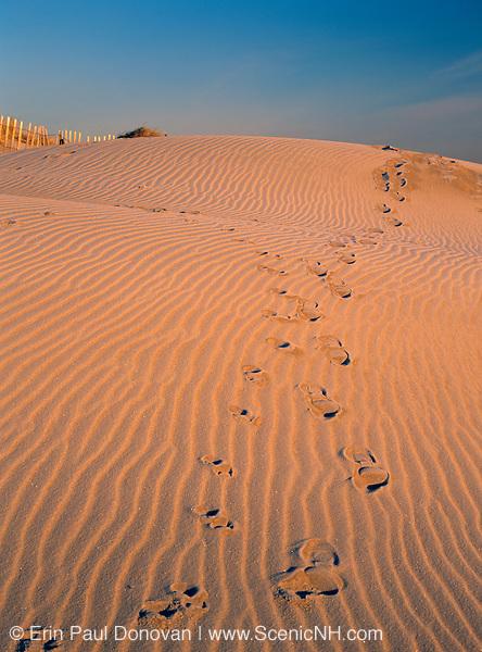 Foot prints in beach sand at Hampton Beach, New Hampshire.