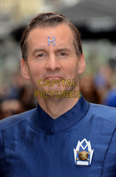 Chris Barrie.Photocall to promote 'Red Dwarf X' exclusively airing on Dave, Prince Charles Cinema, Leicester Square, London, England..October 3rd 2012 .headshot portrait blue h letter forehead .CAP/WIZ.© Wizard/Capital Pictures.