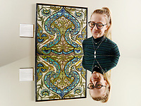 BNPS.co.uk (01202 558833)<br /> Pic: ZcharyCulpin/BNPS<br /> <br /> Pictured: Emma Rowland from the Russell-Coates Art Gallery with a Floral Ogee tile panel. De Morgan created an almost perfectly symmetrical panel apart from the two birds below the centre of the panel. The panel is reflected in a mirror.<br /> <br /> 'Sublime Symmetry' at the Russell-Coates Art Gallery and Museum in Bournemouth, Dorset<br /> <br /> The Sublime Symmetry exhibition showcases the work of William De Morgan. The celebrated Arts and Crafts designer (1939-1917) was seen as the most inventive ceramic designer of the Victorian period.  The exhibition explores the Mathematics behind De Morgan's Ceramic designs.