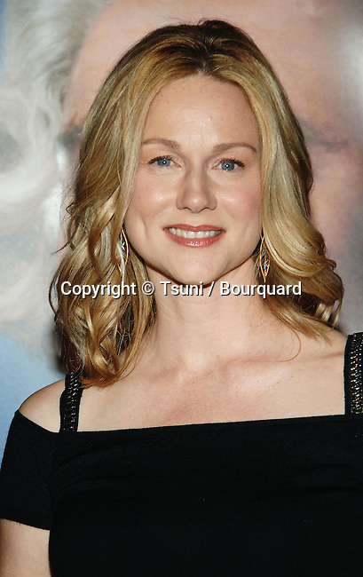 Laura Linney arriving at MAN OF THE YEAR premiere at the Chinese Theatre  In Los Angeles.<br /> <br /> headshot<br /> smile<br /> eye contact