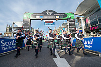 Picture by Allan McKenzie/SWpix.com - 17/05/2018 - Cycling - OVO Energy Tour Series Mens Race Round 3:Aberdeen - The pipe band plays up the finishing straight, gantry, OVO Energy, branding.