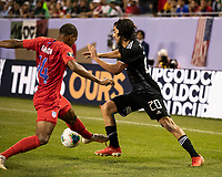 CHICAGO, IL - JULY 7: Rodolfo Pizarro #20 is defended by Reggie Cannon #14 during a game between Mexico and USMNT at Soldiers Field on July 7, 2019 in Chicago, Illinois.