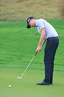 Chris Kirk (USA) putts on the 1st green during Thursday's Round 1 of the 2014 BMW Masters held at Lake Malaren, Shanghai, China 30th October 2014.<br /> Picture: Eoin Clarke www.golffile.ie