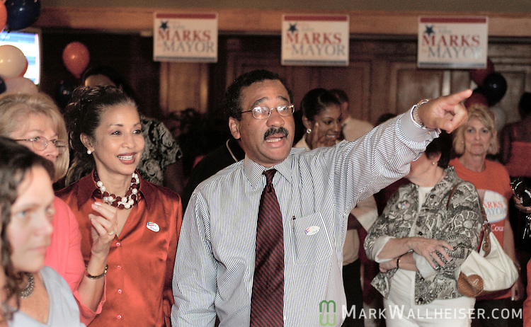 Tallahassee Mayor John Marks, right, points out his election results on the television to his wife Jayne, center, and his campaign workers and friends gathered at his election headquarters on West College Avenue September 5, 2006.