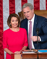 Speaker of the United States House of Representatives Nancy Pelosi (Democrat of California), left, and US House Minority Leader Kevin McCarthy (Republican of California), right, at the Speaker's chair as the 116th Congress convenes for its opening session in the US House Chamber of the US Capitol in Washington, DC on Thursday, January 3, 2019. Photo Credit: Ron Sachs/CNP/AdMedia