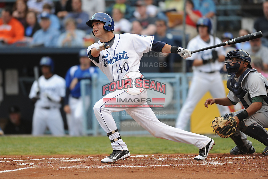 Asheville Tourists Mark Tracy #40 swings at a pitch during a game against  the Lexington Lengends at McCormick Field in Asheville,  North Carolina;  April 18, 2011. Asheville defeated Lexington 4-1.  Photo By Tony Farlow/Four Seam Images