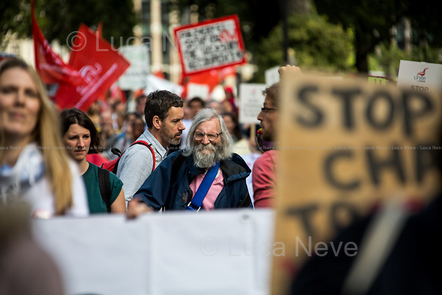 London, 26/09/2015. Today, hundreds of people held a march from Old Palace Yard to Downing Street to protest against the introduction of new rules in the British Government's Access to Work scheme which is designed to help and support deaf and disable people to work. From the organisers Facebook page: &lt;&lt;[&hellip;] The Department of Work and Pension's Access to Work scheme is supposed to make sure that Deaf and disabled people are able to work on an equal basis to non-disabled people. But... they are cutting our access, so we are losing our jobs and finding it even harder to get new ones. We want to work and have careers, but the Government won't let us. [&hellip;]&gt;&gt;.<br /> <br /> For more information please click here: http://on.fb.me/1OYR5ZV &amp; http://on.fb.me/1gYoLJ6<br /> <br /> To sign the online petition please click here: http://bit.ly/1dOC7hW