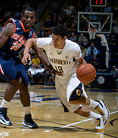 Brandon Smith of California dribbles the ball away from Caleb Willis of Pepperdine during the game at Haas Pavilion in Berkeley, California on November 13th, 2012.  California defeated Pepperdine, 79-62.
