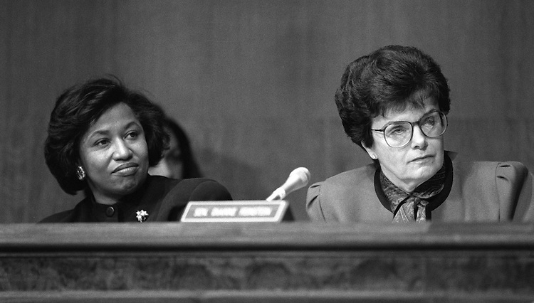 1/19/93.ZOE BAIRD CONFIRMATION HEARING--Sen. Carol Moseley-Braun, D-Ill., and Sen. Dianne Feinstein, D-Calif., during the Senate Judiciary confirmation hearing for Zoe Baird to be the U.S. Attorney General..CONGRESSIONAL QUARTERLY PHOTO BY MICHAEL JENKINS
