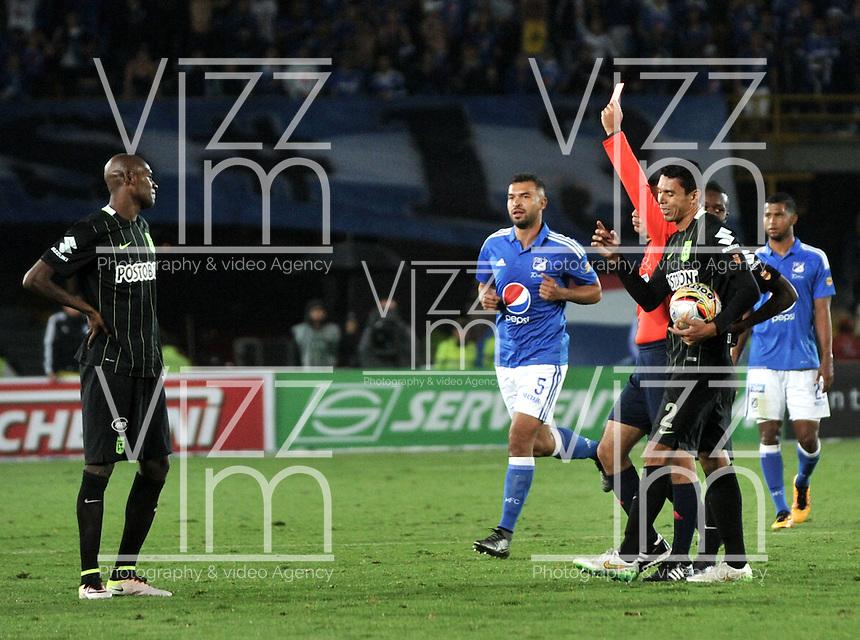 BOGOTA - COLOMBIA -31 - 03 - 2016: Luis Sanchez (Der), arbitro, muestra tarjeta roja a Victor Ibarbo (Izq.) jugador de Millonarios, durante partido aplazado de la fecha 9 entre Millonarios y Atletico Nacional, de la Liga Aguila I-2016, jugado en el estadio Nemesio Camacho El Campin de la ciudad de Bogota.  / Luis Sanchez (R), referee, shows red card to Victor Ibarbo (L), player of Millonarios, during a postponed match between Millonarios and Atletico Nacional,  for the date 9 of the Liga Aguila I-2016 at the Nemesio Camacho El Campin Stadium in Bogota city, Photo: VizzorImage / Luis Ramirez / Staff.