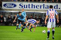 VOETBAL: HEERENVEEN: Abe Lenstra Stadion, SC Heerenveen - Ajax, 11-01-2012, Eindstand 0-5, Daley Blind (#17), Sven Kums (#10), ©foto Martin de Jong