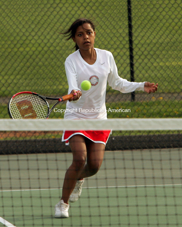 BEACON FALLS, CT-21 APRIL 2010-042110JS09-Wolcott's Alaysia Trotman returns a shot during the doubles match against Woodland Wednesday at Woodland High School in Beacon Falls. <br /> Jim Shannon Republican-American
