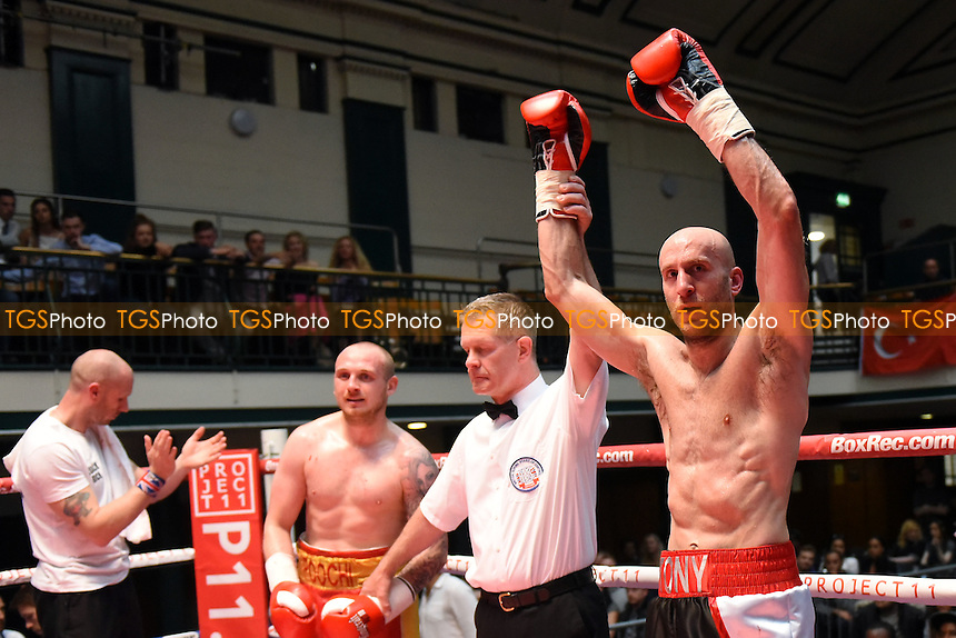 Tony Milch (black/white shorts) defeats Lewis van Poetsch during a Boxing Show at York Hall on 4th June 2016