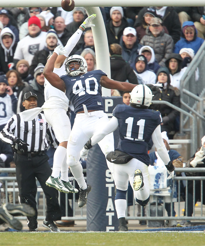 State College, PA - 11/26/2016:  Penn State LB Jason Cabinda defends a pass in the end zone intended for Michigan State WR R.J. Shelton. #7 Penn State defeated Michigan State by a score of 45-12 to secure the Big Ten conference East Division championship on Senior Day, Saturday, November 26, 2016, at Beaver Stadium in State College, PA.<br /> <br /> Photos by Joe Rokita / JoeRokita.com