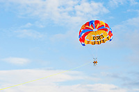 Tourist Couple Parasailing over Lake Taupo, Waikato Region, North Island, New Zealand. There are endless activities on offer at Taupo, with the majority, including parasailing, revolving around Lake Taupo, the largest lake in New Zealand.