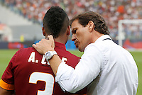 Calcio, Serie A: Roma vs Cagliari. Roma, stadio Olimpico, 21 settembre 2014.<br /> Roma coach Rudi Garcia, of France, gives suggestions to defender Ashley Cole, of Britain, left, prior to the start of the Italian Serie A football match between AS Roma and Cagliari at Rome's Olympic stadium, 21 September 2014.<br /> UPDATE IMAGES PRESS/Riccardo De Luca