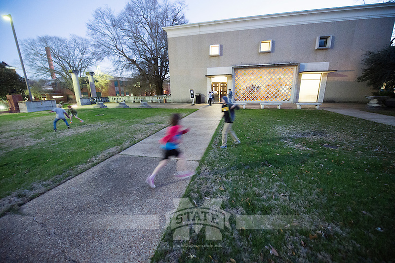Science Night at the Museum (Darwin Week): Children playing outside Cobb Institute.<br />  (photo by Megan Bean / &copy; Mississippi State University)