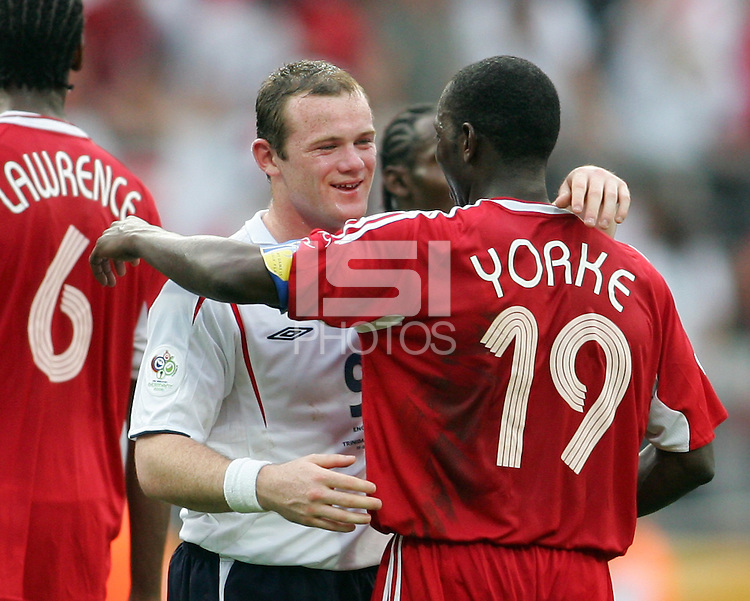 Wayne Rooney of England and Dwight Yorke of Trinidad about to embrace after the game. England defeated Trinidad & Tobago 2-0 in their FIFA World Cup group B match at Franken-Stadion, Nuremberg, Germany, June 15 2006.