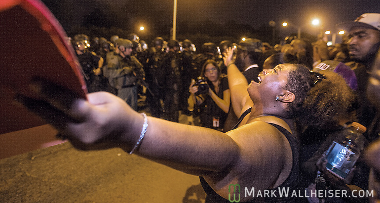 BATON ROUGE, LA -JULY 09: Gina Key-Conrad pleads with Baton Rouge police in riot gear as they move in on the protesters over the Alton Sterling shooting on July 9, 2016 in Baton Rouge, Louisiana. Alton Sterling was shot by a police officer in front of the Triple S Food Mart in Baton Rouge on July 5th, leading the Department of Justice to open a civil rights investigation. (Photo by Mark Wallheiser/Getty Images)