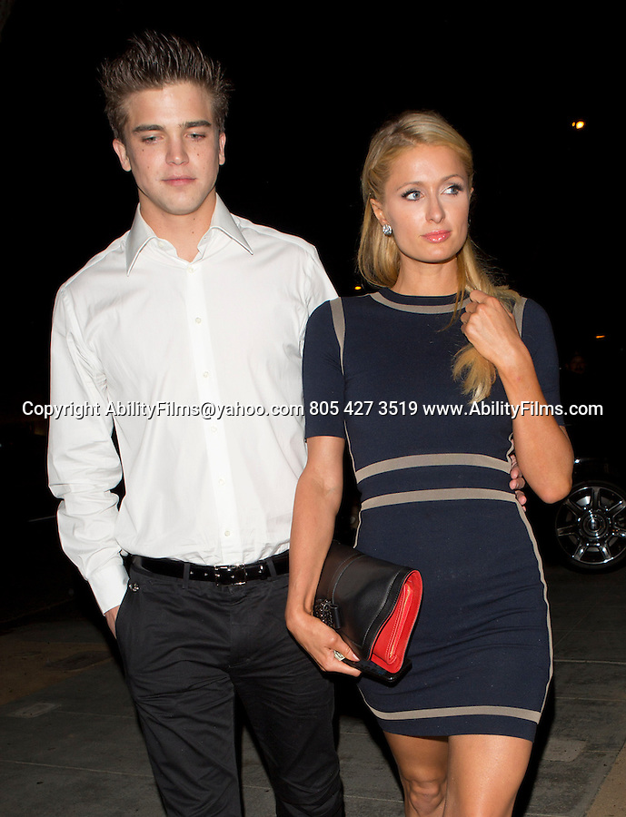 November 7th 2012 <br /> <br /> Paris &amp; Kathy &amp; Richard Hilton with River Viiperi arriving at Barron Hiltons 23rd birthday dinner at the palm steak house restaurant in West Hollywood. Wearing a blue dress black red purse matching her Ferrari <br /> <br /> AbilityFilms@yahoo.com<br /> 805 427 3519<br /> www.AbilityFilms.com