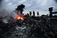 Burning wreckage on the crash site of flight MH17 Malaysian Airways Boeing 777, Hrabove, Eastern Ukraine