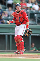 Catcher Jordan Procyshen (29) of the Greenville Drive in a game against the Savannah Sand Gnats on Friday, August 22, 2014, at Fluor Field at the West End in Greenville, South Carolina. Greenville won, 6-5. (Tom Priddy/Four Seam Images)